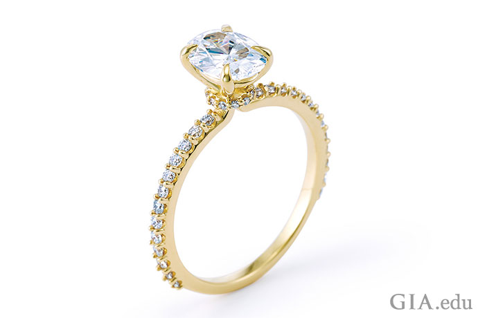 A gold diamond engagement ring.
