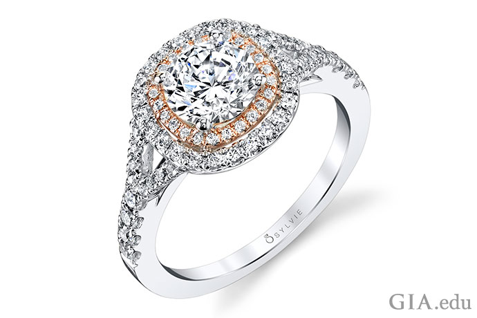 A 1 ct round brilliant diamond engagement ring surrounded by a double halo of melee diamonds set in white and rose gold.