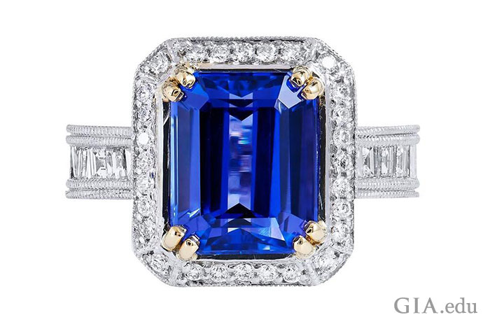 4.91 ct tanzanite, which mimics the deep blue of fine sapphire, and its regal frame of diamonds.