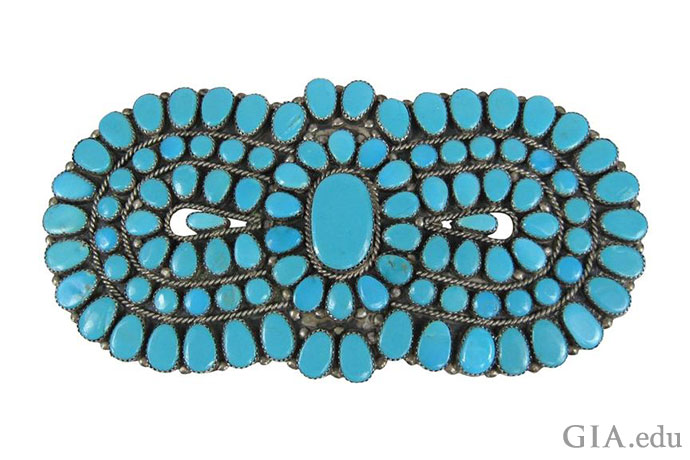 An artisan from the Zuni tribe made this turquoise brooch.
