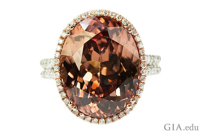 A 19.76 ct orangy brown zircon is ringed by 0.51 carats of diamonds.