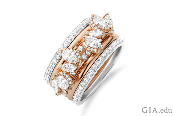 Here's proof that five wedding bands are maybe better than one. Marquise diamonds in the center band add a dash of edgy elegance, while the white gold and rose gold outer bands create a dramatic contrast.