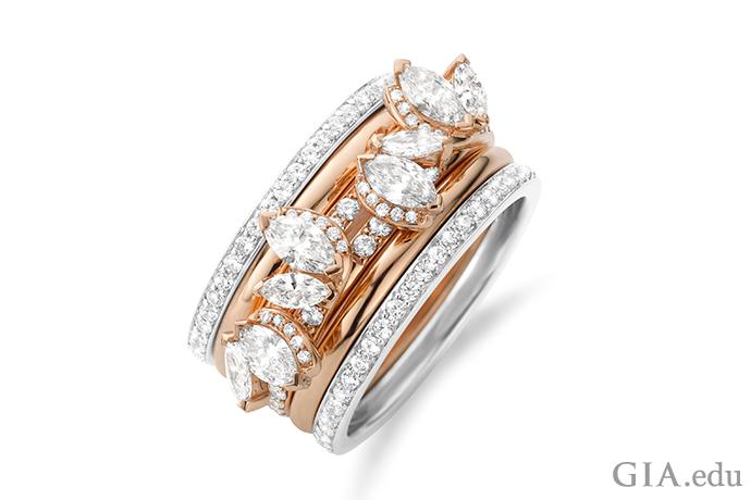 5本の結婚指輪の方が1本よりもよいかもしれないと証明してくれる例。中央の指輪に使われているマーキーズダイヤモンドが躍動感とともにすっきりした優雅さを放つ一方で、外側の指輪のホワイトゴールドとローズゴールドが強いコントラストを生み出している。