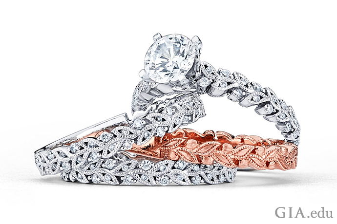 A rose gold band adds a dramatic splash of color when bracketed between two bands in white gold. A subtle touch: The pattern in the rose gold ring is echoed in the diamond wedding bands.