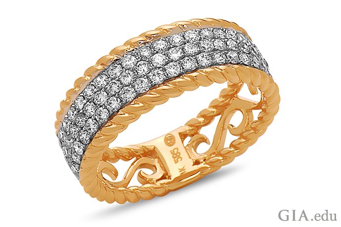 Rows of pavé-set diamonds sparkling in this wedding band are guaranteed to catch the eye.