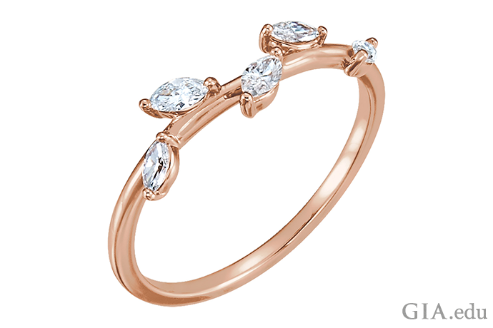 "This wedding band is a ""natural"" delight: The 14K rose gold band plays the part of a branch, and diamonds are the leaves."