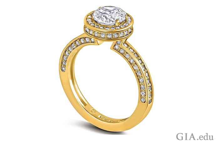 An 18K yellow gold band provides the perfect contrast to this 1 ct round brilliant diamond.