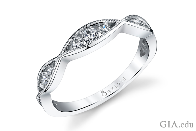 Milgrain (a close-set row of metal beads) has been a popular way to adorn engagement rings for over a century. The technique instantly creates a vintage look for today's wedding bands.