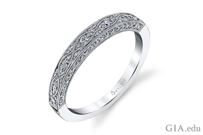 With its ornate design and generous use of milgrain, this contemporary wedding band could have been discovered in an antique shop. Sweetening the design are 0.37 carats of diamonds.