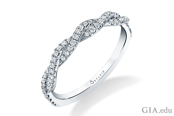 Two intertwined rows of diamonds (0.25 carats total weight) brighten this twisted wedding band.