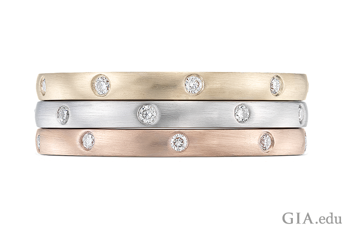 Stackable wedding bands of 14K yellow gold, rose gold and white gold.