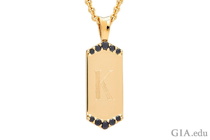 14K gold. A dog tag never looked so fashionable.