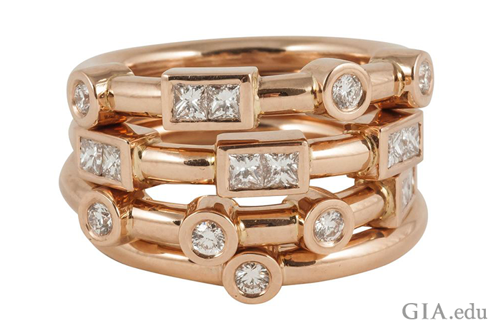 "Four wedding bands in rose gold make a serious statement. The piece also has a hidden message: The dots and dashes are Morse code for ""love."""