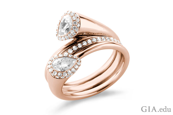 Rose gold Toi et Moi triple band engagement ring.