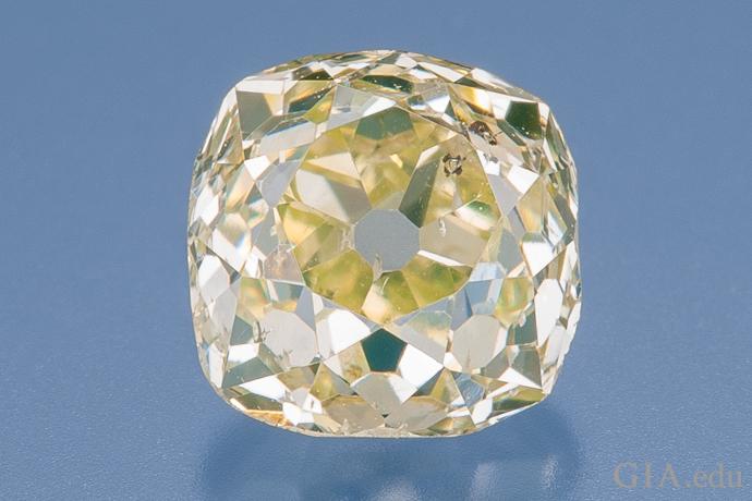 A 0.68 carat old mine cut diamond.