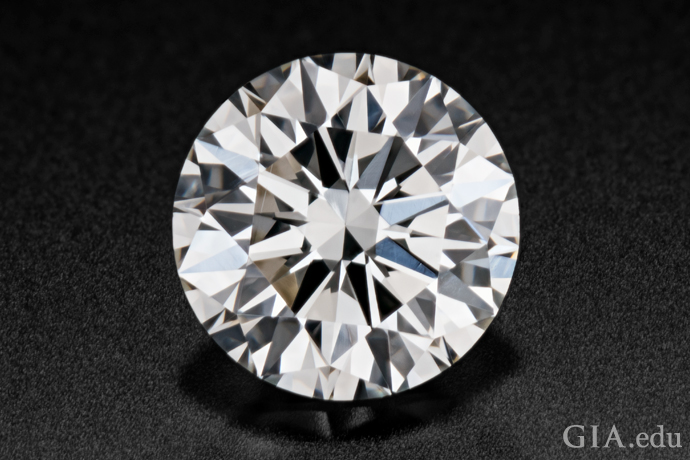 A 0.73 carat round brilliant cut diamond.