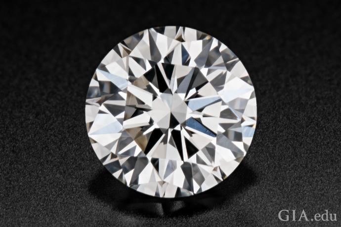 A 0.73 carat round brilliant cut diamond.