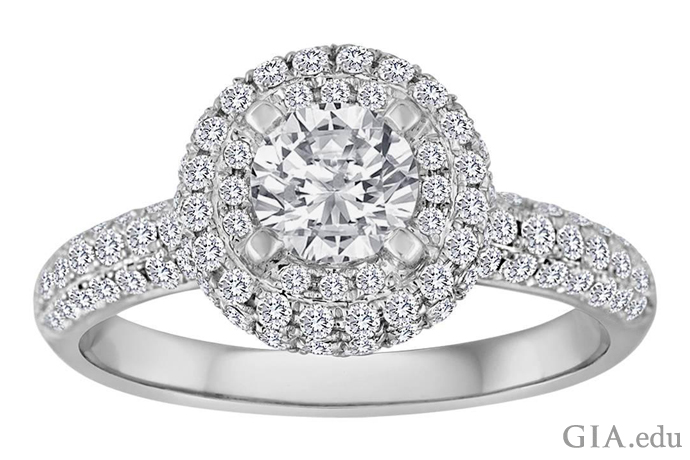 A 6.75 carat round brilliant cut diamond engagement ring featuring a diamond melee halo and band.