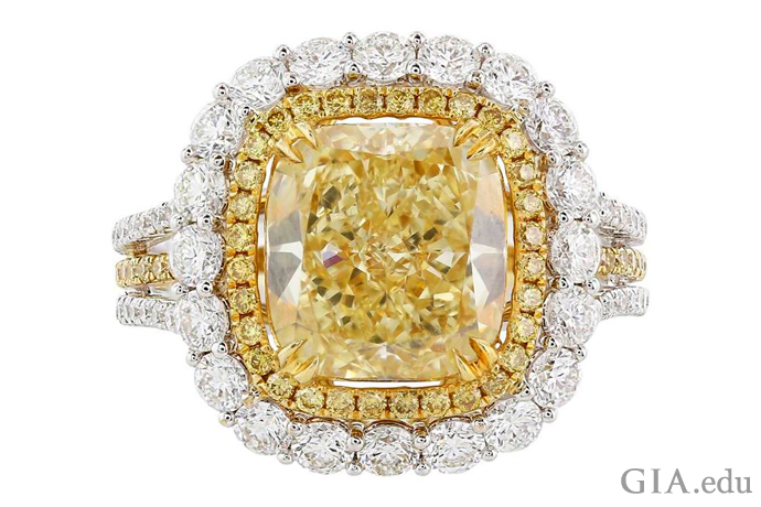 A 3.66 ct Fancy Yellow diamond engagement ring with two halos containing 0.37 carats of yellow diamonds and 1.50 carats of colorless diamonds.