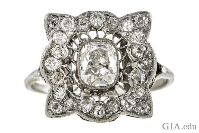 A 1.12 carat cushion cut diamond engagement ring with 0.48 carats of melee.