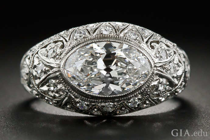 A 1.63 carat elongated oval diamond engagement ring surrounded by milgrain and delicate open work.