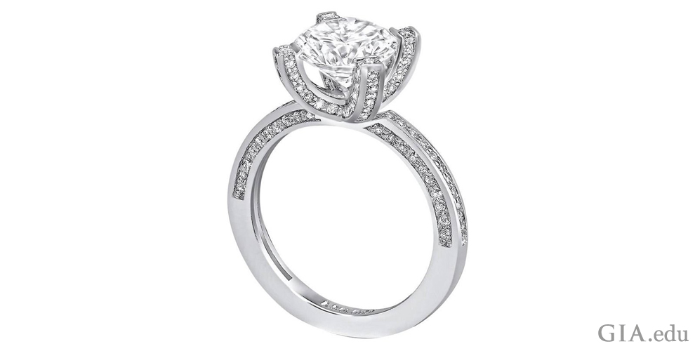 1 carat diamond engagement ring with diamonds set in the prongs and shank.