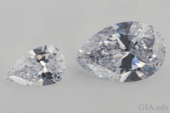 These pear shaped diamonds display a bow-tie effect, the dark area that extends across the width of each stone.