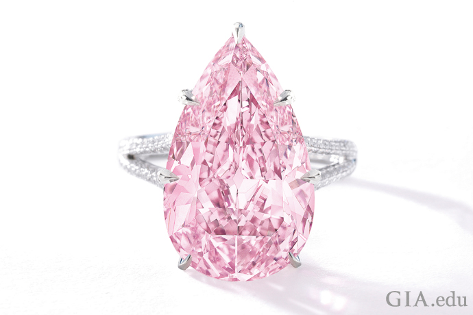 An 8.41 ct Fancy Vivid purple-pink pear shaped diamond ring.
