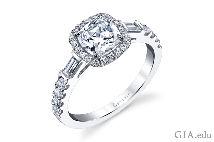 A cushion cut diamond engagement ring.
