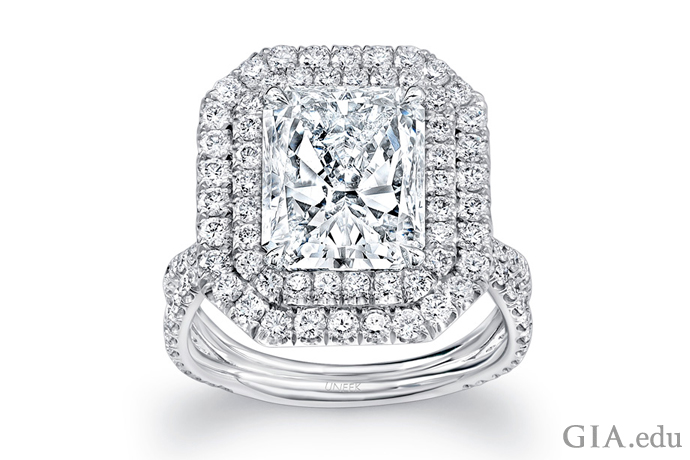 A 4.00 carat radiant cut diamond engagement ring wrapped with two diamond halos.