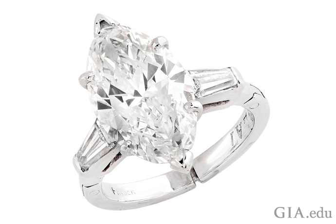 A 3.50 carat marquise shaped diamond engagement ring set in platinum.