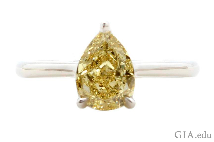 A 1.39 carat fancy yellow pear shaped diamond engagement ring.