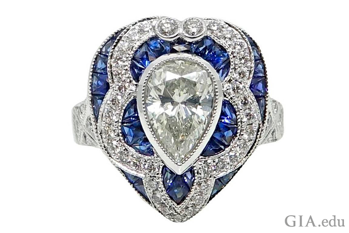A 1.34 ct Art Deco style pear shaped diamond engagement ring with radiant cut diamonds and sapphires.