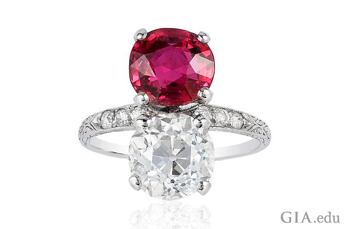 A vintage engagement ring featuring a 3.03 carat old European cut diamond and a 3.01 carat ruby.