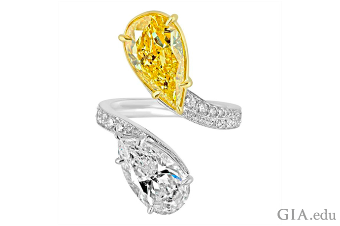 A 4.04 ct yellow pear shaped diamond and 3.02 ct colorless pear shaped diamond in a bypass engagement ring setting.