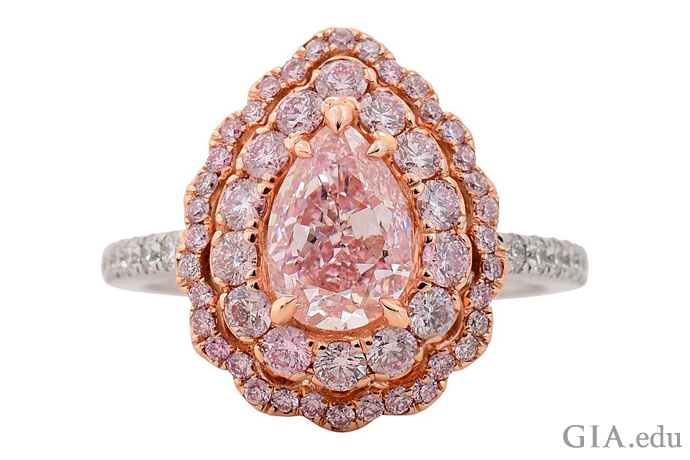A 1.21 ct Fancy purplish pink pear shaped diamond engagement ring set in 18K gold.