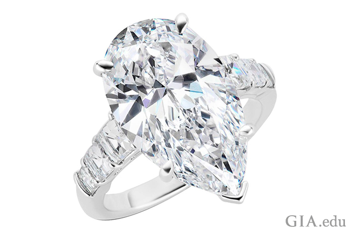 An 8.25 ct pear shaped diamond engagement ring in a V-prong platinum setting.
