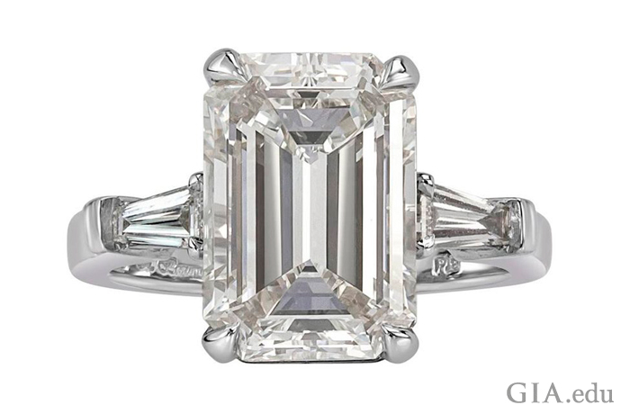 A 5.89 carat emerald cut diamond engagement ring.