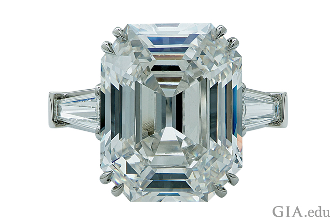 A 10.21 carat emerald cut diamond engagement ring with a clarity grade of VS2.