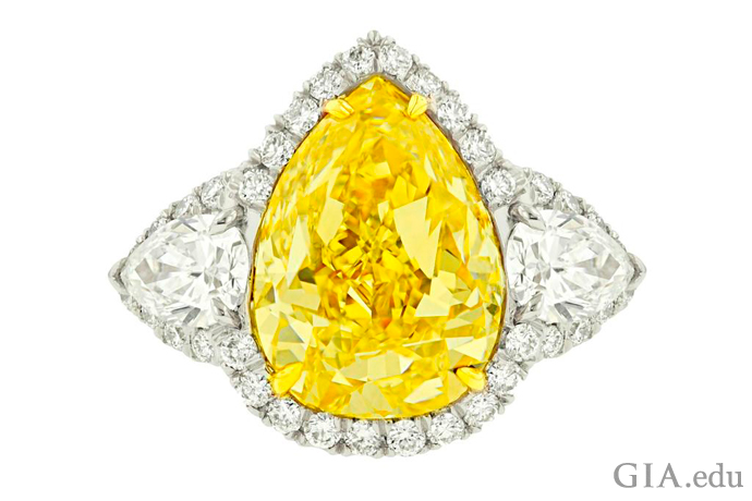 A 5.33 carat Fancy Yellow pear shaped diamond.