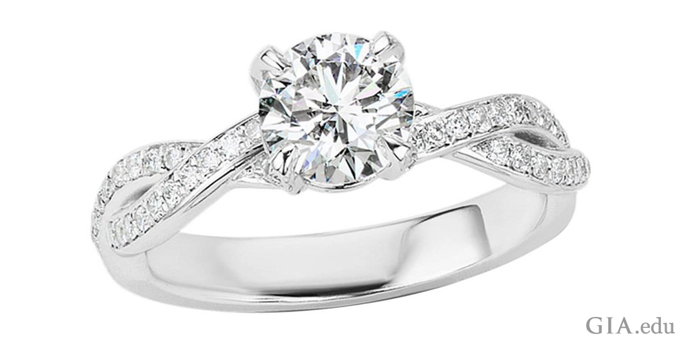 A 1.01 ct round brilliant cut diamond engagement ring.
