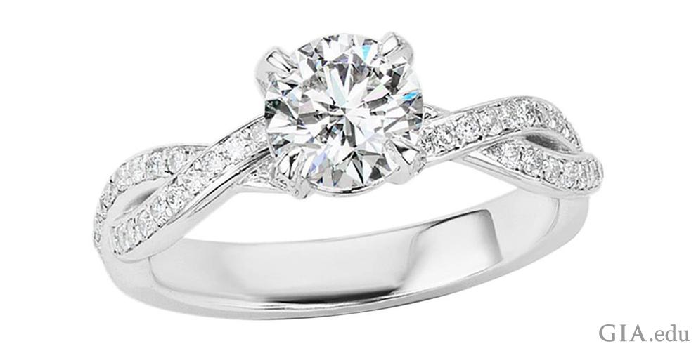 A 1.01 ct round brilliant cut diamond engagement ring.