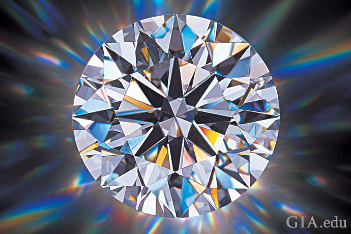 Round brilliant cut diamond showing good brightness, fire and scintillation when the diamond is moved.