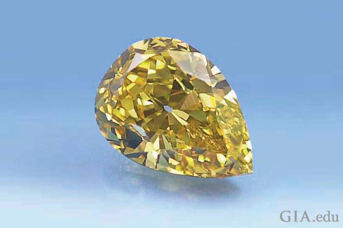 一颗 10.12 克拉的艳彩梨形黄色钻石。