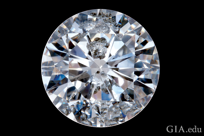 A round brilliant cut diamond with inclusions and blemishes.