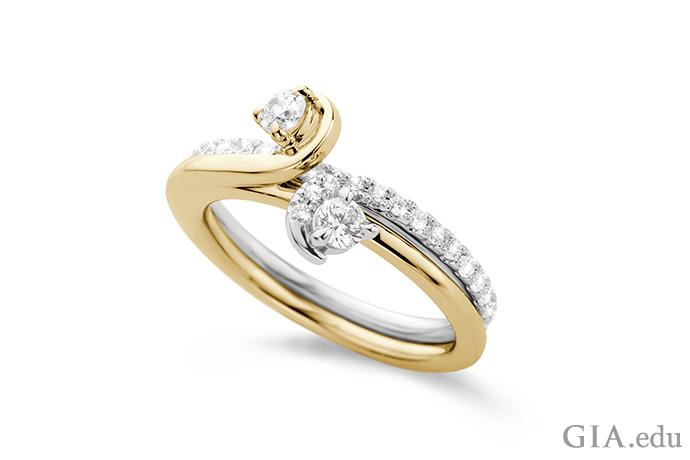 黄金和白金戒圈交织缠绕的钻石订婚戒指。