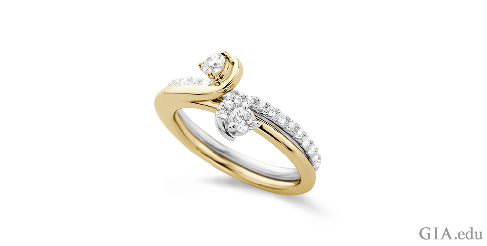 Bypass diamond engagement with intertwining yellow gold and white gold band.