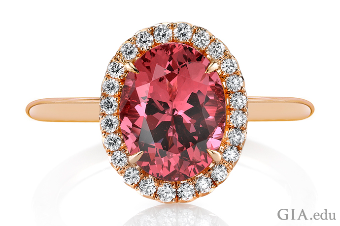 A gemstone engagement ring featuring a 2.57 ct spinel encircled by 0.20 carats of round diamonds.