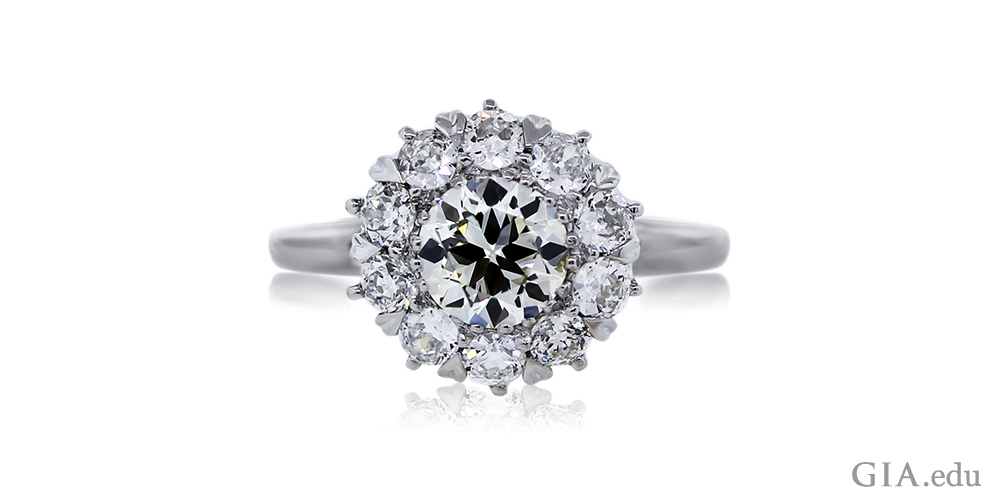 A 1.01 ct old European cut diamond with a halo of 0.91 carats of diamonds.