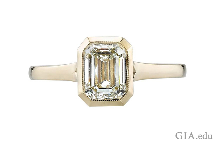 An N-color diamond engagement ring set in a yellow gold.